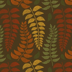leaf fronds in fall colors on brown