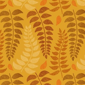 leaf fronds in fall colors on mustard