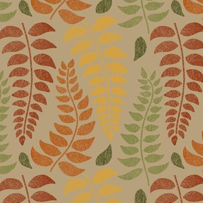 leaf fronds in fall colors on tan