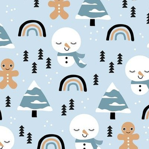 Little winter rainbows and snowy snowman and gingerbread men pine trees christmas holiday blue caramel boys
