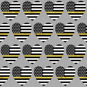 thin gold line flag in hearts on grey