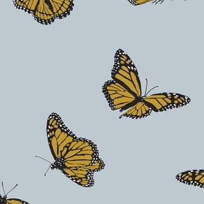 Golden Monarch Butterflies on Grey