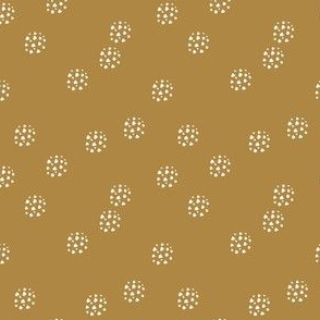 white dotted dots on mustard