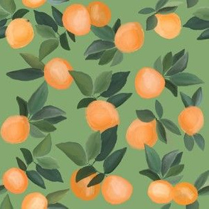 oranges scattered on soft green