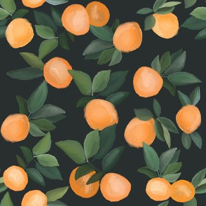 oranges scattered on soft black