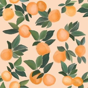 oranges scattered on  peachy cream