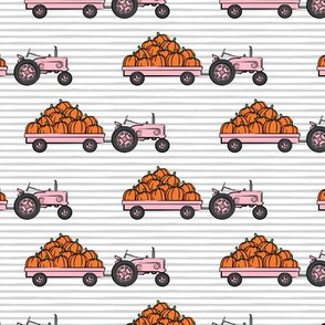 Pumpkin Patch - pink tractor (on stripes) pulling pumpkins - LAD19