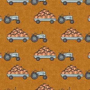 Pumpkin Patch - blue tractor (on cider) pulling pumpkins - LAD19