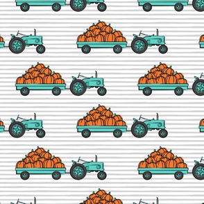 Pumpkin Patch -  bright teal tractor (on stripes) pulling pumpkins - LAD19