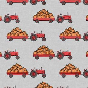 Pumpkin Patch - Red tractor (grey) pulling pumpkins - LAD19