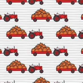 Pumpkin Patch - Red tractor (grey stripes) pulling pumpkins - LAD19