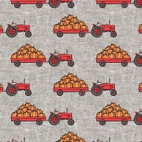 Pumpkin Patch - Red tractor pulling pumpkins - LAD19