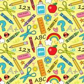 small school supplies on yellow