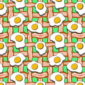 eggs and bacon on green