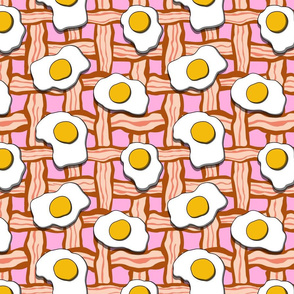 eggs and bacon on pink