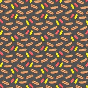 (micro scale) hot dog on dark grey with condiments C19BS
