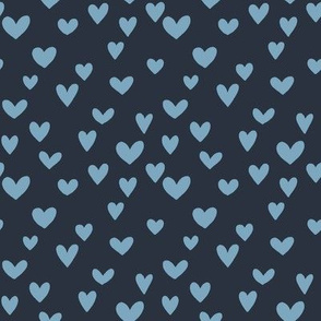 Blue hearts on dark background