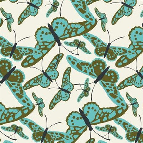 Butterfly scatterfly blue and green on ivory