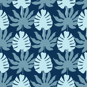 Monstera tropical leaves on dark blue