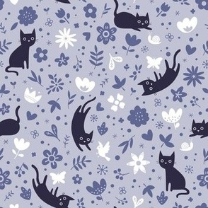 Cats frolicking in the garden (lavender)