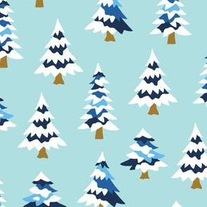 Blue pine trees with snow mint