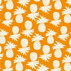 White pineapples with orange background