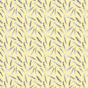 Feathers on yellow background