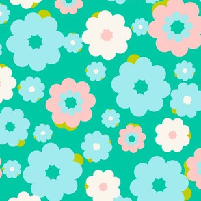 Small blue, white and pink flowers over a turquoise background