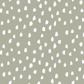 medium // scattered marks white on gray green