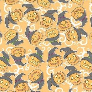 Tossed Witch pumpkins on orange