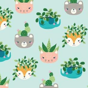 animal planters // fox, bear, elephant and cat with houseplants