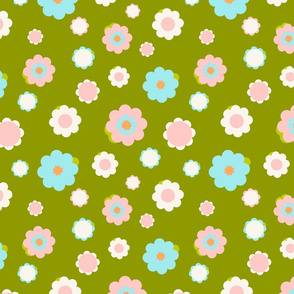 White, blue and pink flowers over green background