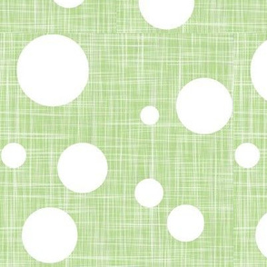 snowfall in spring - white dots on green linen texture