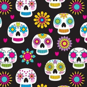 white sugar skulls on black