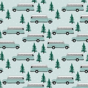 Vintage school bus ride winter mountain peak travels pine tree forest canada theme mint green