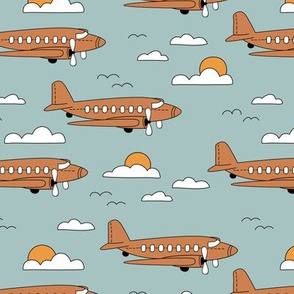 Vintage plane flying air travel clouds and sun boys