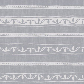 small lines and dots on gray linen