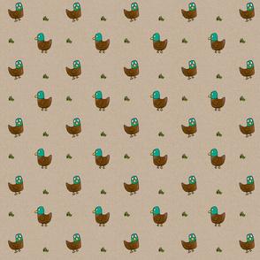 Ducks with grass