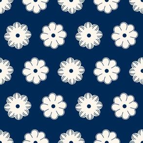 Aligned beige flowers on a dark blue
