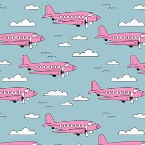 Safe travels vintage plane ride sky big birds and clouds girls pink blue
