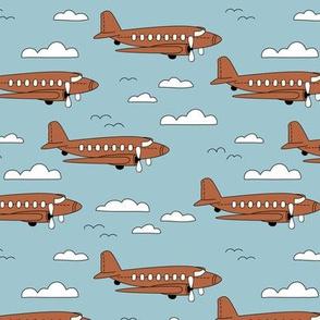 Safe travels vintage plane ride sky big birds and clouds boys blue copper