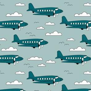 Safe travels vintage plane ride sky big birds and clouds boys winter blue teal