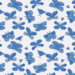 Blue Moths on Light Blue