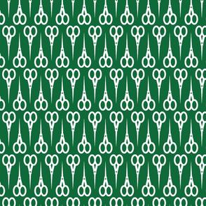 White scissors on green
