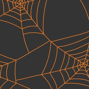 Spiderwebs pumpkin orange on black night - jumbo scale