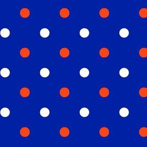 Royal blue and orange team color polka dot blue background