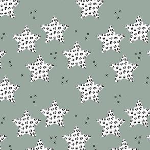 Leopard print stars seasonal Christmas ornaments december palette animal print moss green gray