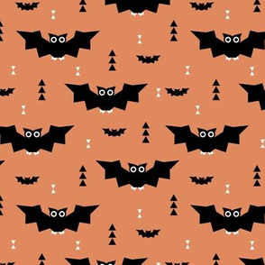Cute little kawaii bat geometric triangles and halloween themed pumpkin orange kids design