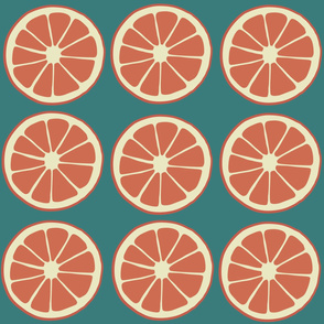 Tropical fruit, citrus fruit, blood orange slices on blue green