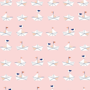 Paper boats in pink